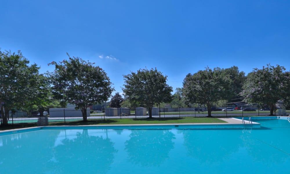 Spacious blue pool outside at Gwynn Oaks Landing Apartments & Townhomes, MD