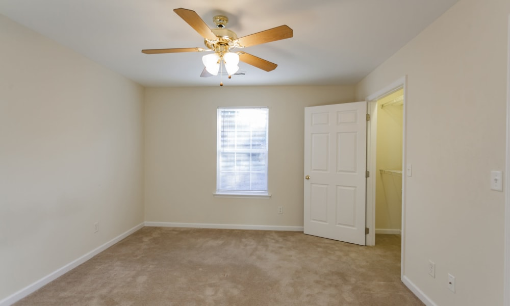 Bedroom with ceiling fan at Home Place Apartments in Chattanooga, Tennessee