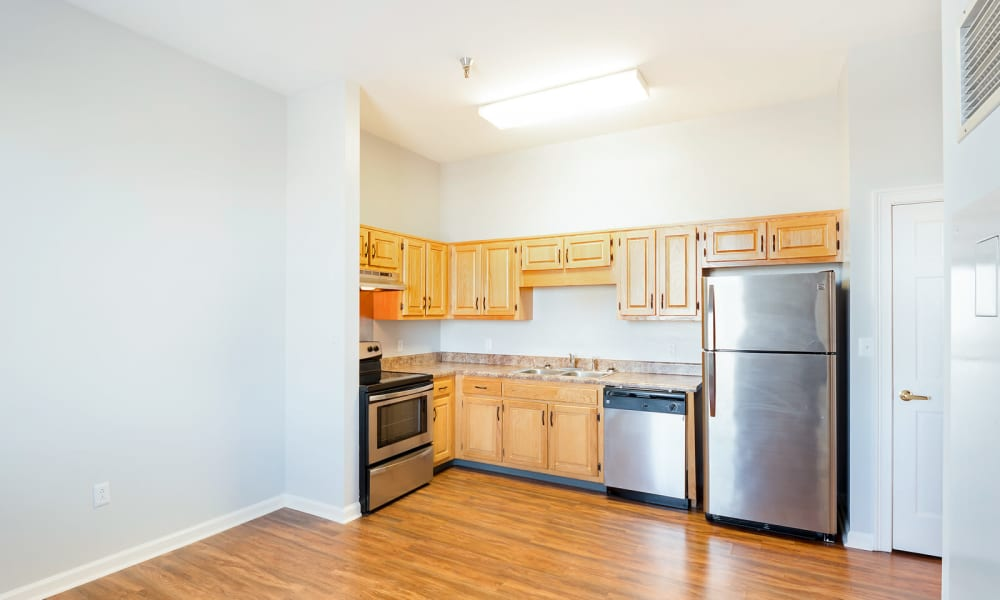 Kitchen with stainless steel appliances at The Grand Apartments in Chattanooga, Tennessee