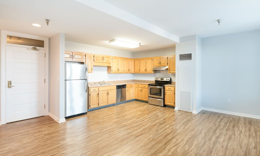 Spacious apartment with wood-style flooring at The Grand Apartments in Chattanooga, Tennessee