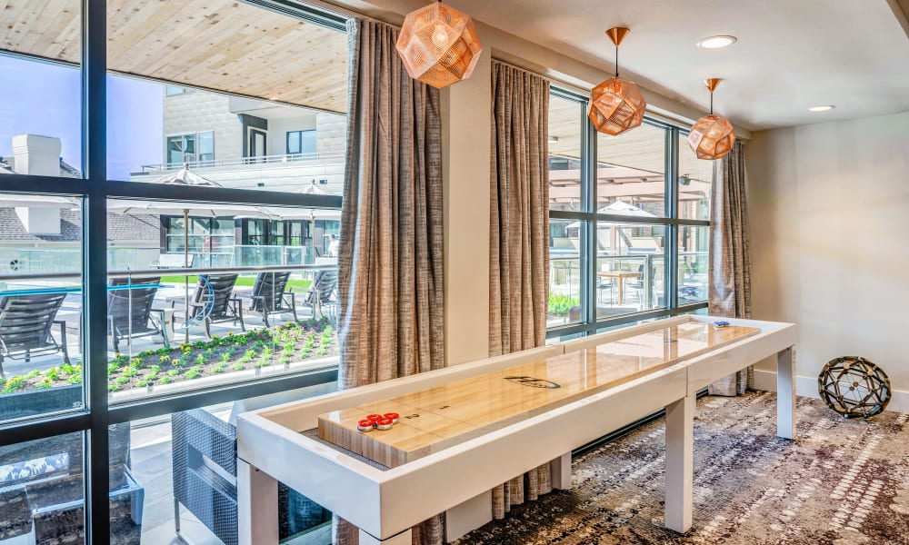 Game room with a view of the pool at Anthology of Tanglewood in Houston, Texas