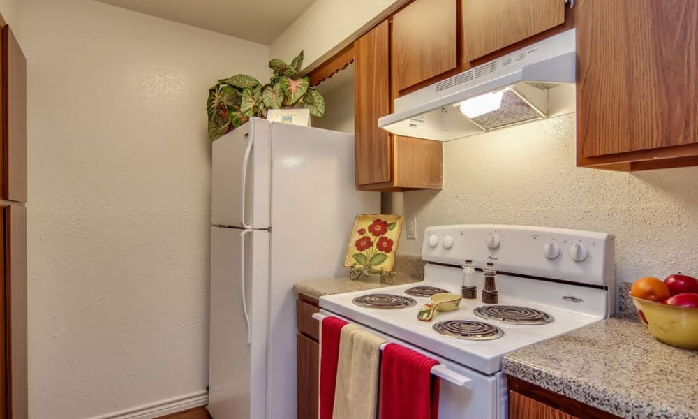 Kitchen with refrigerator and energy-efficient appliances at Cambridge Place in Houston, Texas.