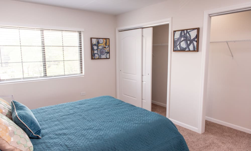 Bright bedroom windows at Pine Hill Apartments in Wheeling, Illinois