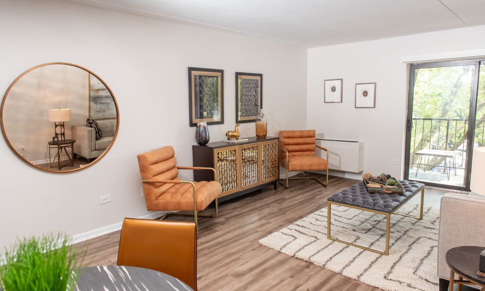 Bright living room at Pine Hill Apartments in Wheeling, Illinois