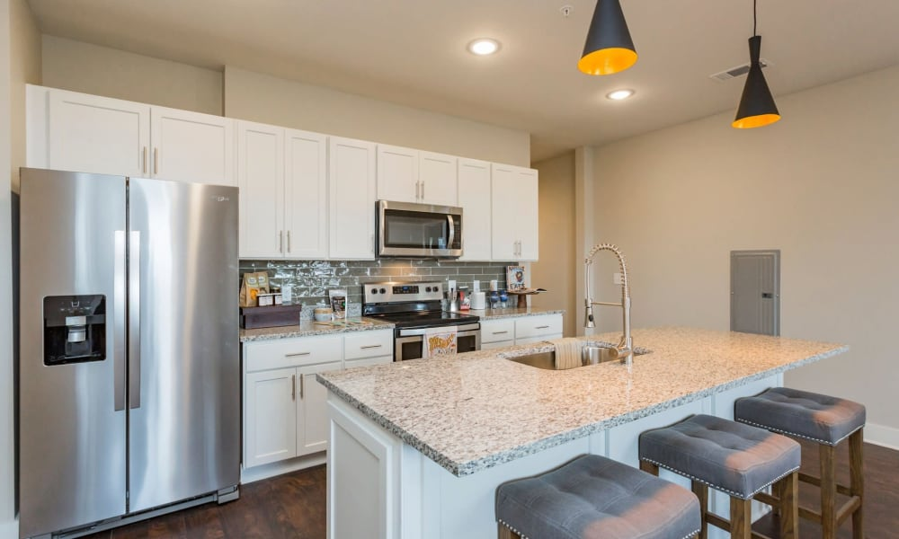 Stainless-steel appliances in the kitchen of a model home at Rivertop Apartments in Nashville, Tennessee