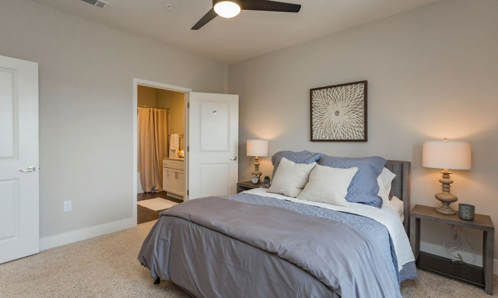 Large master bedroom in a model home at Rivertop Apartments in Nashville, Tennessee
