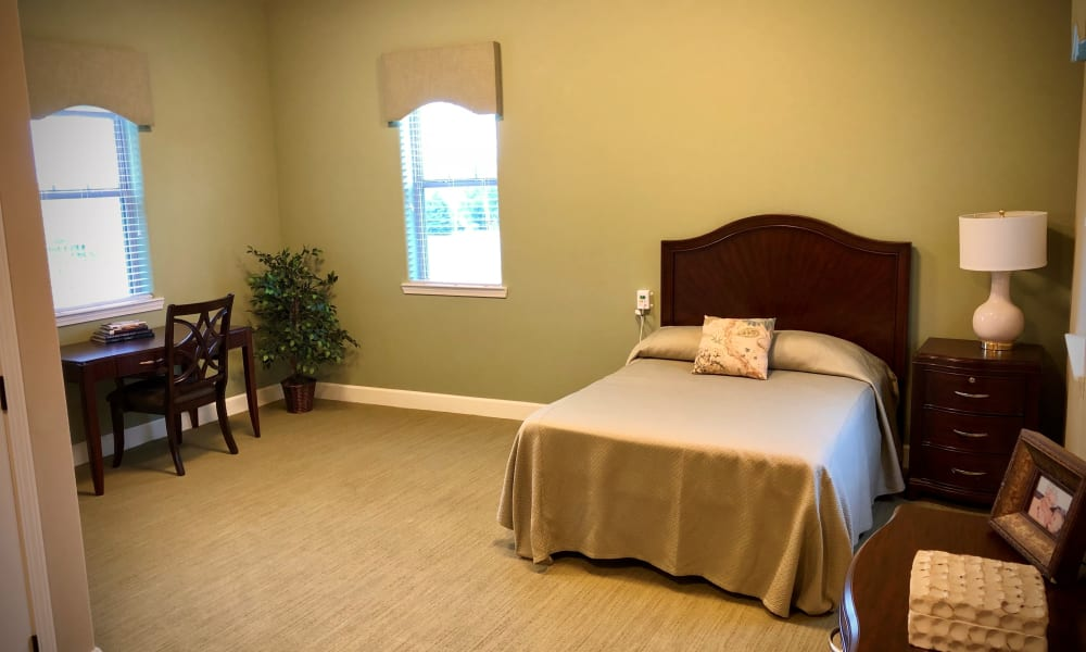 Large bedroom at Willow Creek Memory Care at Lee's Summit in Lee's Summit, Missouri