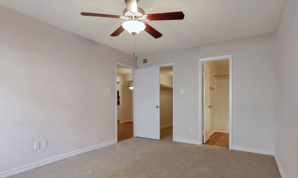 Bedrooms with large closets and ceiling fans at Crystal Bay in Webster, Texas.