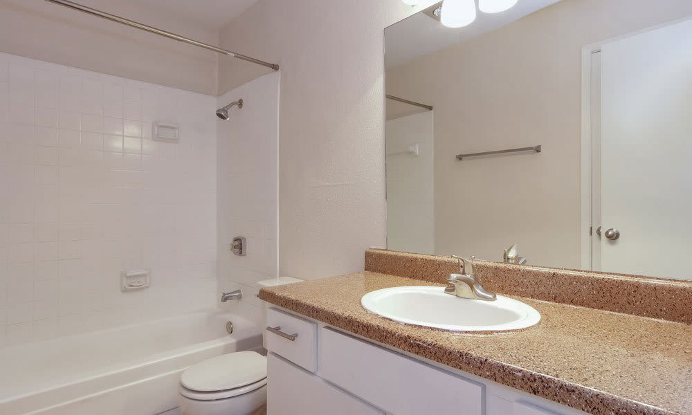 Spacious bathroom with a large mirror at Crystal Bay in Webster, Texas.