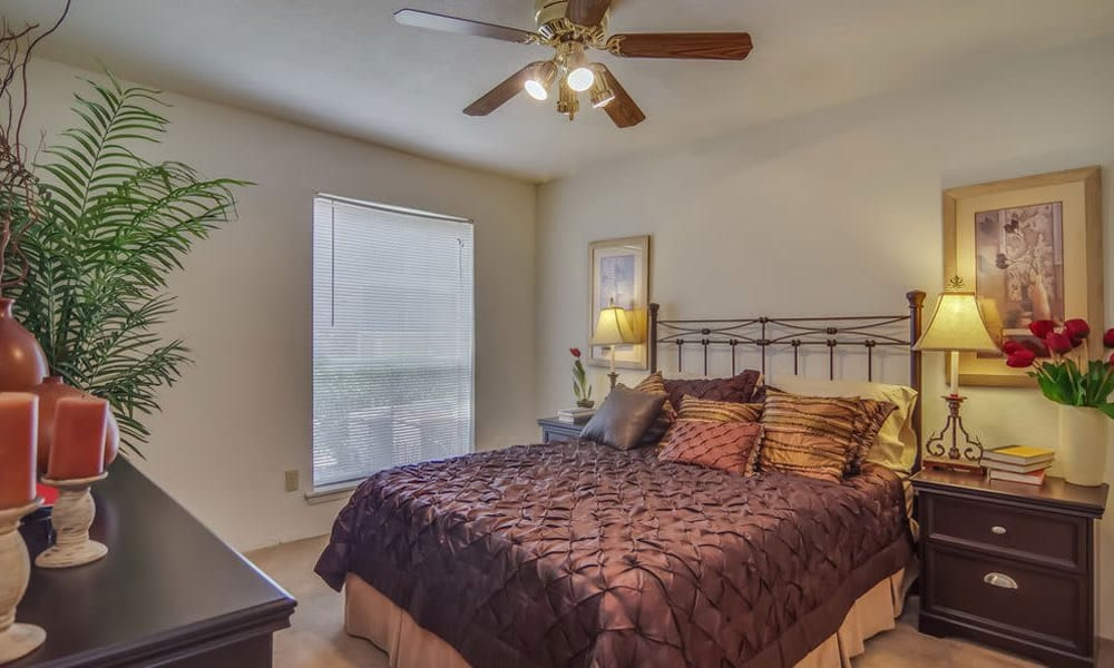 Spacious bedrooms with large windows at Crystal Bay in Webster, Texas.
