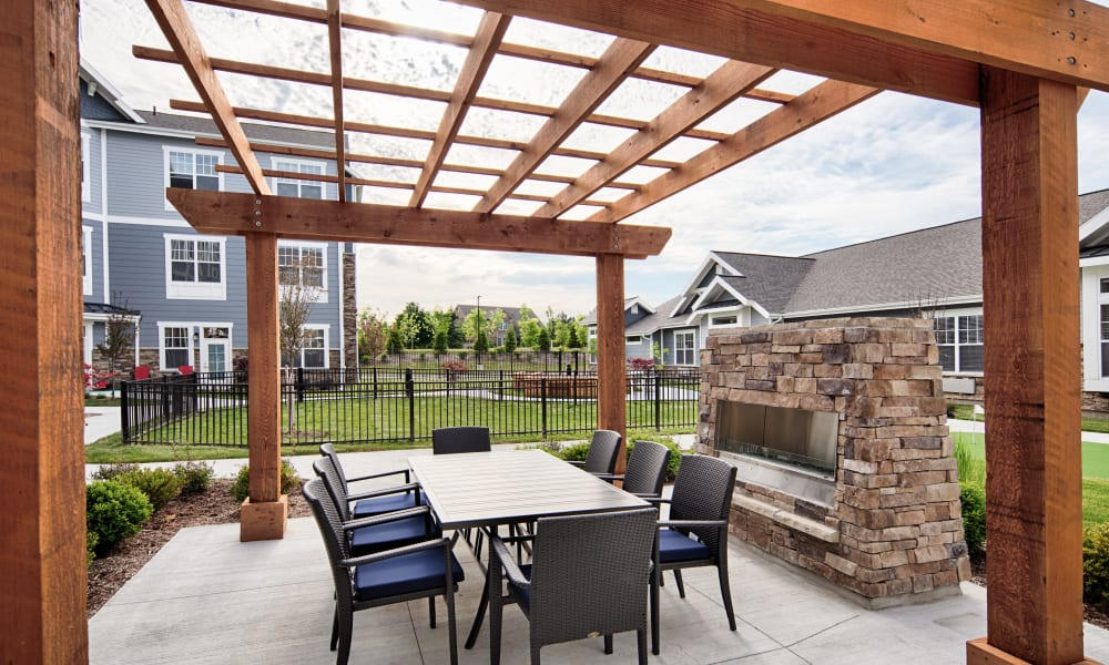 Patio with a grill and seating at Anthology of Northville in Northville, Michigan