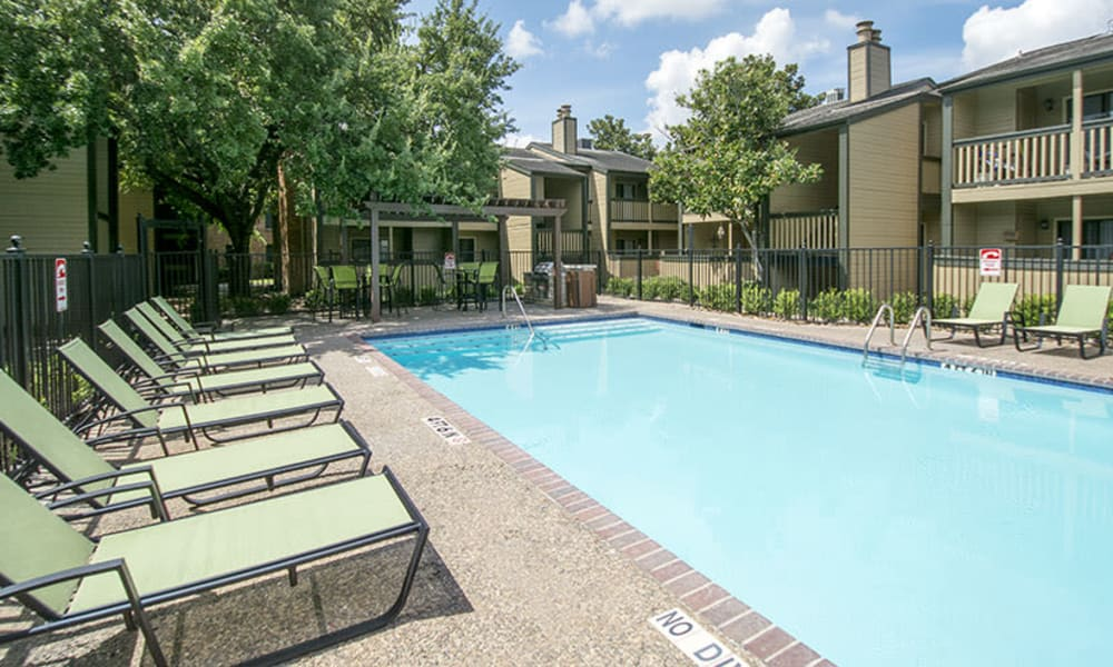 Pool with lounge chairs at Stonecrossing of Westchase in Houston, Texas.