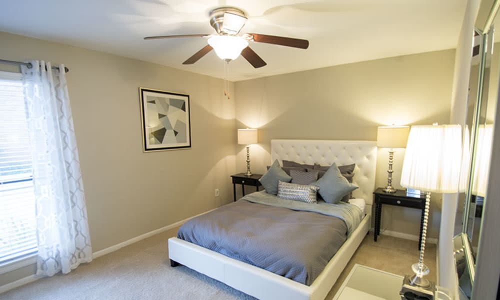 bedroom with large windows at Stonecrossing of Westchase in Houston, Texas.