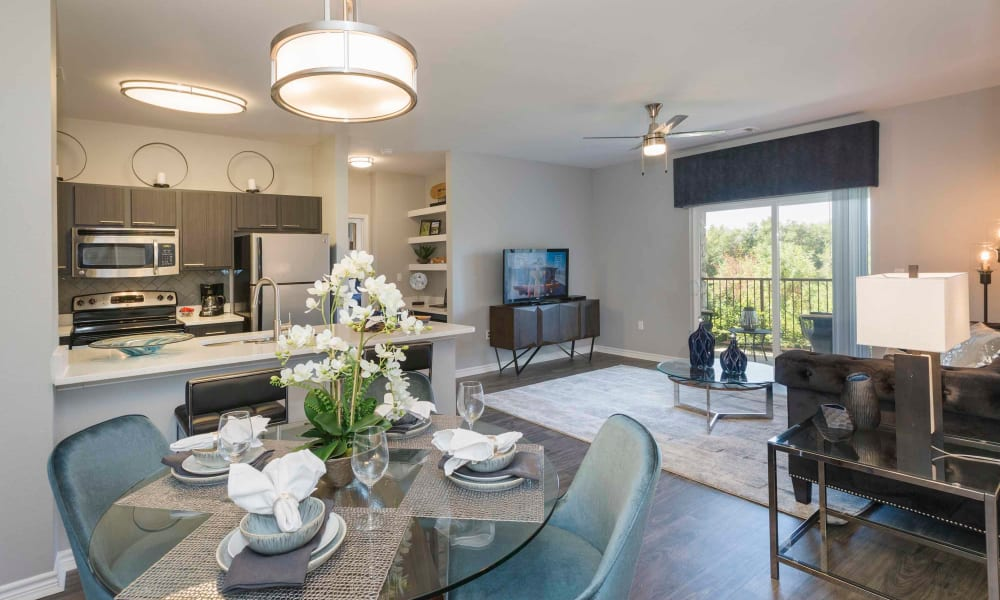 Kitchen and living space at Peaks at Woodmen Apartments