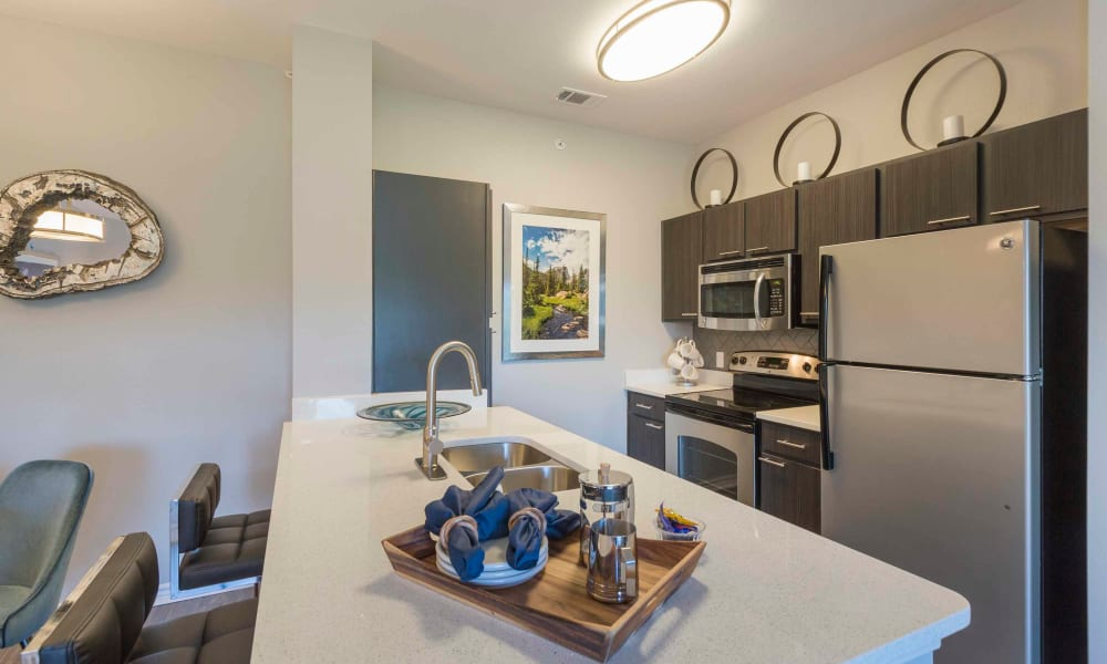 Recently renovated kitchen at Peaks at Woodmen Apartments