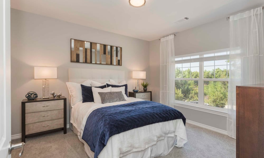 Well lit bedroom at Peaks at Woodmen Apartments