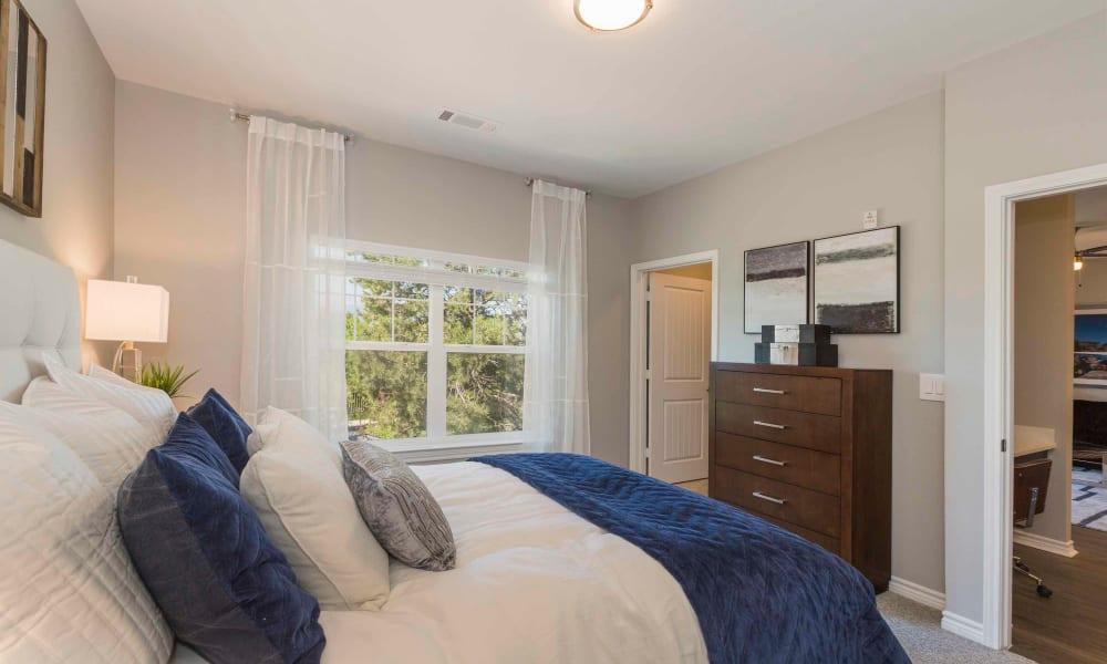 Spacious master bedroom at Peaks at Woodmen Apartments