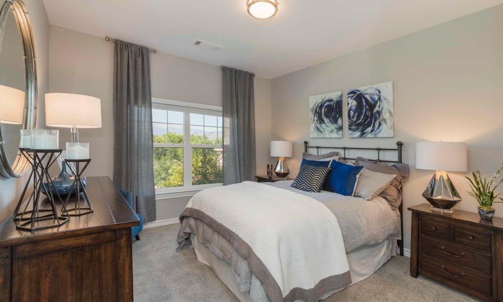 Beautiful master bedroom at Peaks at Woodmen Apartments