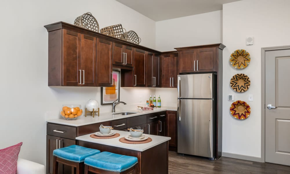 Wood flooring and stainless steel appliances in an apartment kitchen at Anthology of Anderson Township in Cincinnati, Ohio