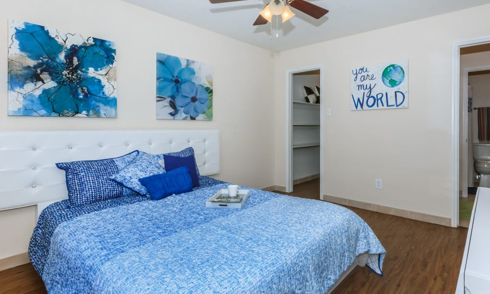 Wood flooring in an apartment bedroom at The Vibe at Clear Lake in Webster, Texas
