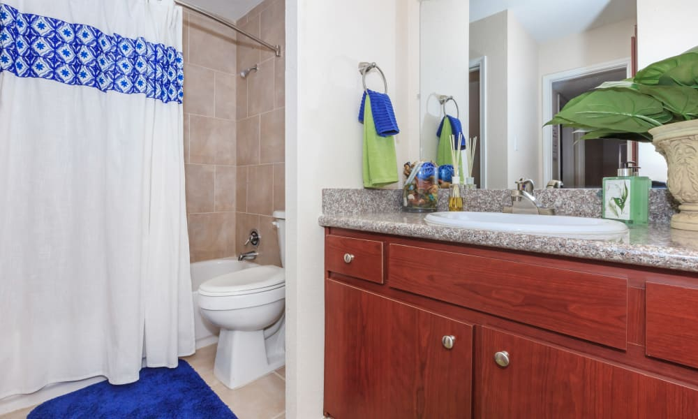 Tile flooring in an apartment bathroom at The Vibe at Clear Lake in Webster, Texas