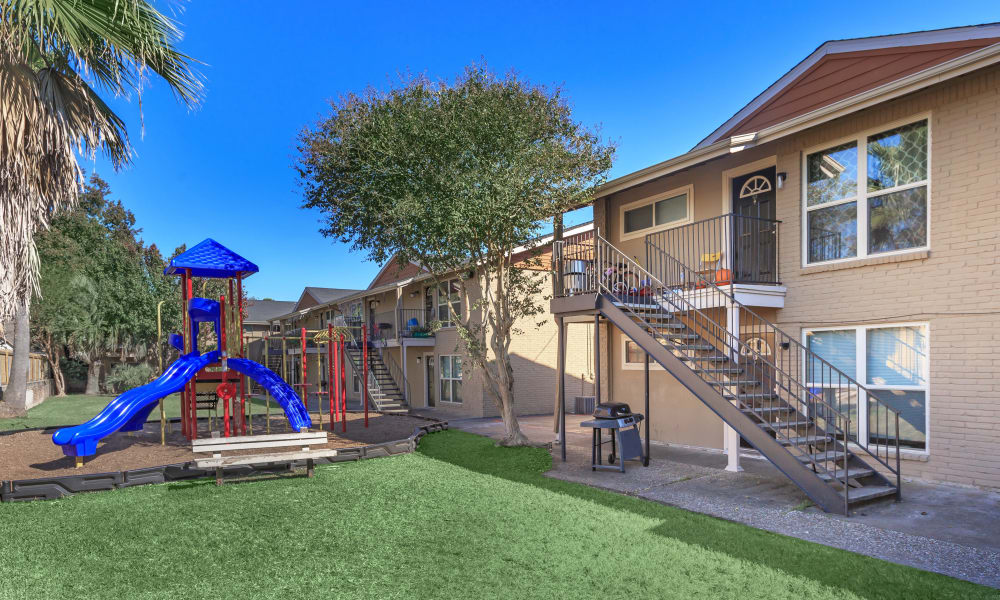 A playground between apartment buildings at The Vibe at Clear Lake in Webster, Texas