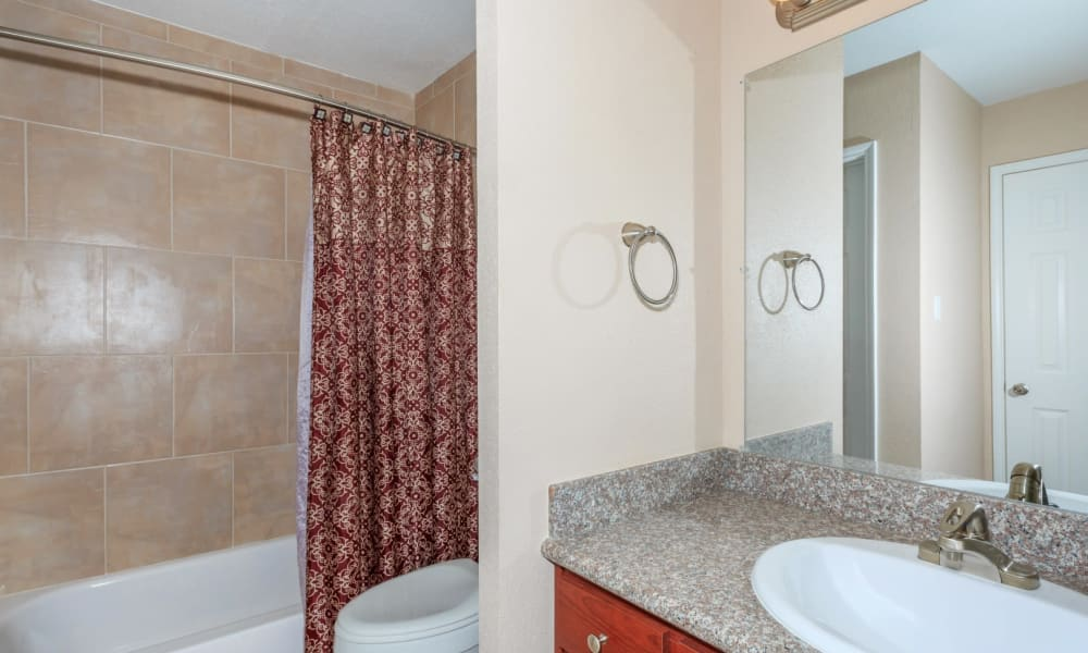 An apartment bathroom at The Vibe at Clear Lake in Webster, Texas