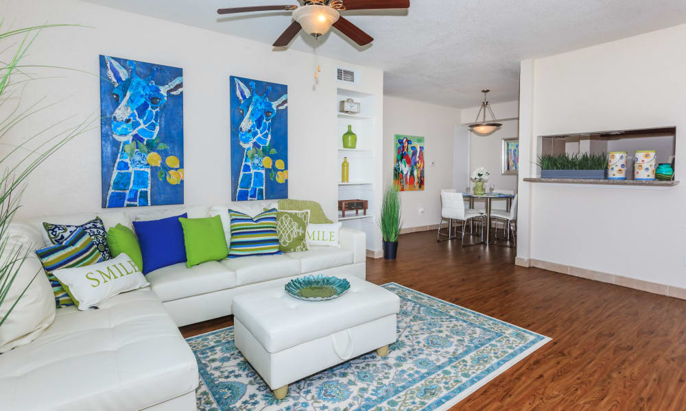 Wood flooring in an apartment living room and dining room at The Vibe at Clear Lake in Webster, Texas