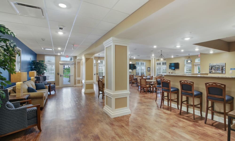 Spacious dining room with bar seating at Keystone Place at Terra Bella in Land O' Lakes, Florida.