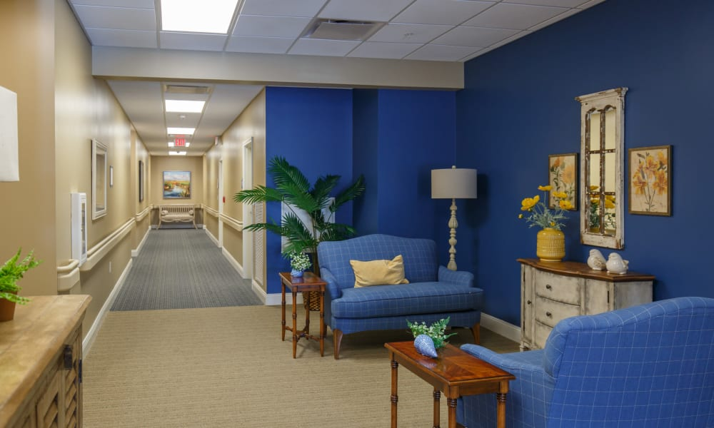 Community hallway with seating at Keystone Place at Terra Bella in Land O' Lakes, Florida.