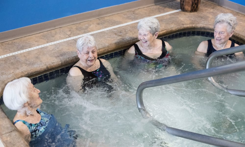 Some resident women enjoying the hot tub at The Keystones of Cedar Rapids in Cedar Rapids, Iowa