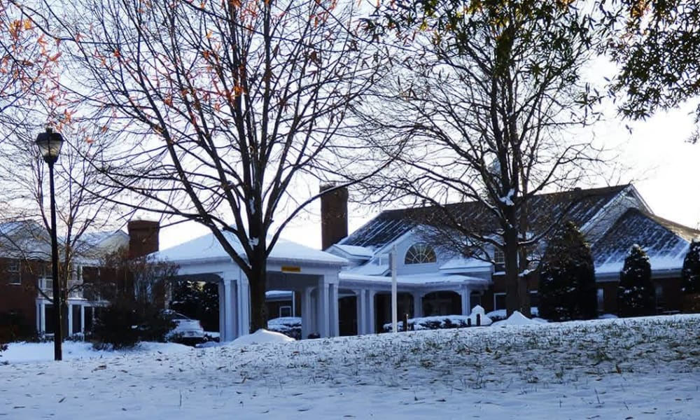 Exterior of building with snow on the ground at Chancellor's Village in Fredericksburg, Virginia