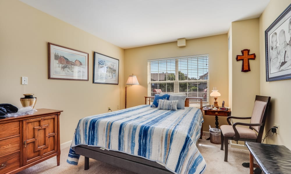 Model resident bedroom at Keystone Place at Legacy Ridge in Westminster, Colorado.