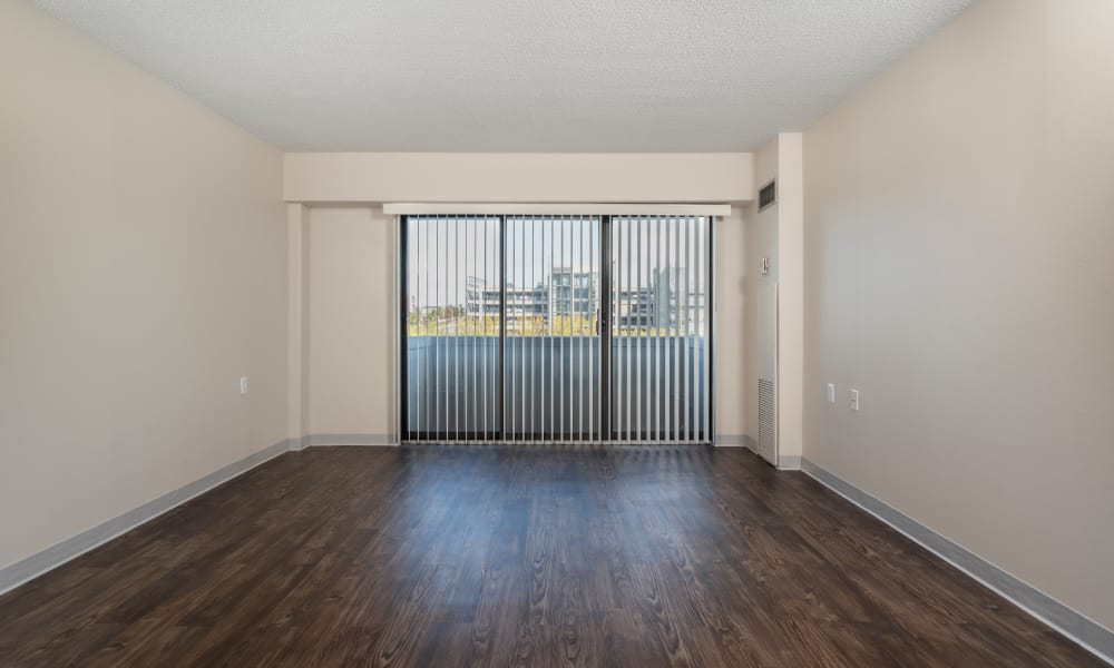 Hardwood floors are offered in Living Room at The Parker @ Seventh in Des Moines, Iowa