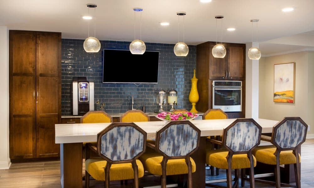 Upscale kitchen with a bar at Anthology of Burlington Creek in Kansas City, Missouri
