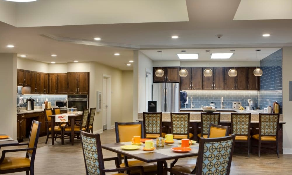 Dining room with a kitchen and bar at Anthology of Burlington Creek in Kansas City, Missouri