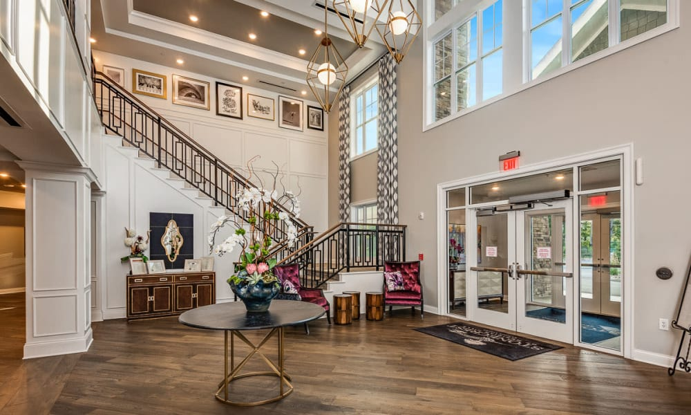 Entryway with grand staircase at Anthology of Meridian Hills in Indianapolis, Indiana