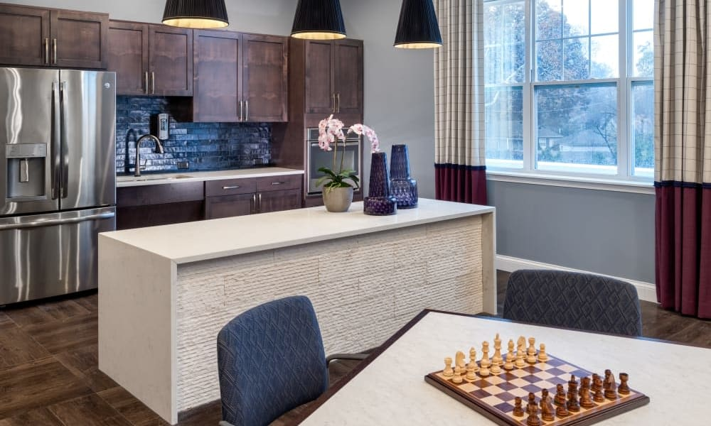 Community room with kitchen at Anthology of Meridian Hills in Indianapolis, Indiana