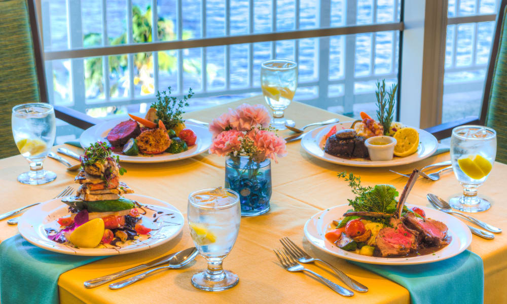 Beautifully dressed meals set at a table for four at The Meridian at Waterways in Fort Lauderdale, Florida