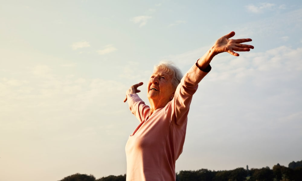 Woman raising her arms after exercising near The Retreat at Jasper in Jasper, Georgia
