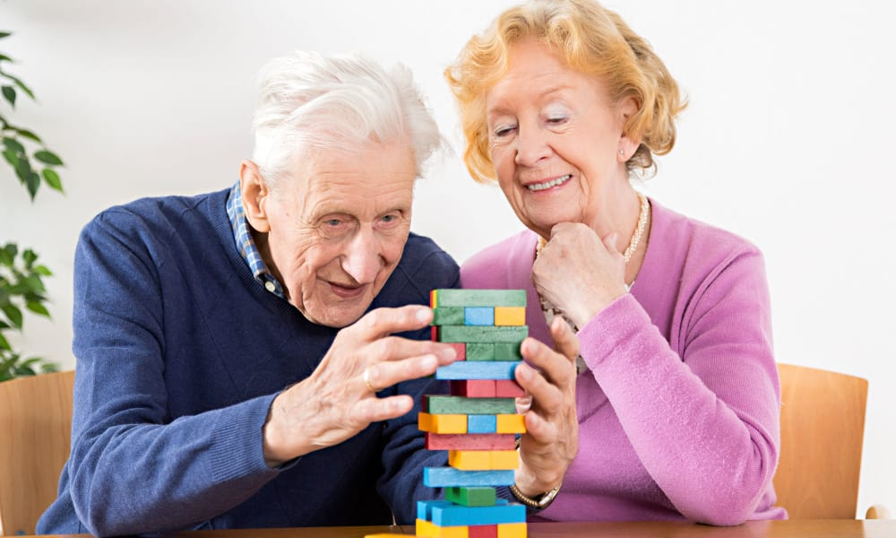 Two residents playing jenga at The Phoenix at Greer in Greer, South Carolina