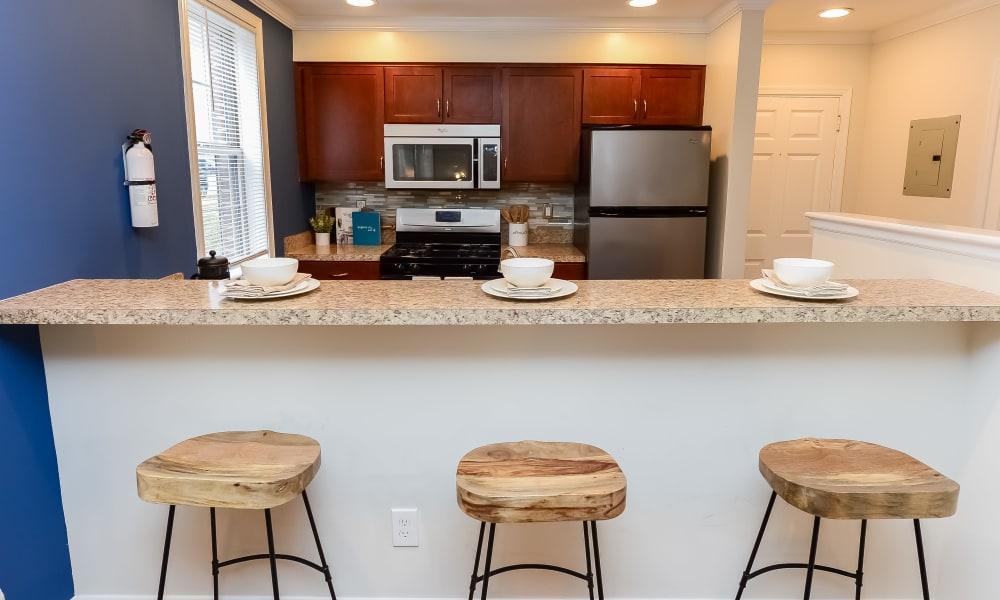 Kitchen with bar stools at The Villas at Bryn Mawr Apartment Homes