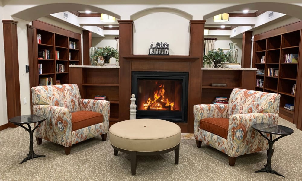 Fireside seating in the library at Wilshire Estates Gracious Retirement Living in Silver Spring, Maryland