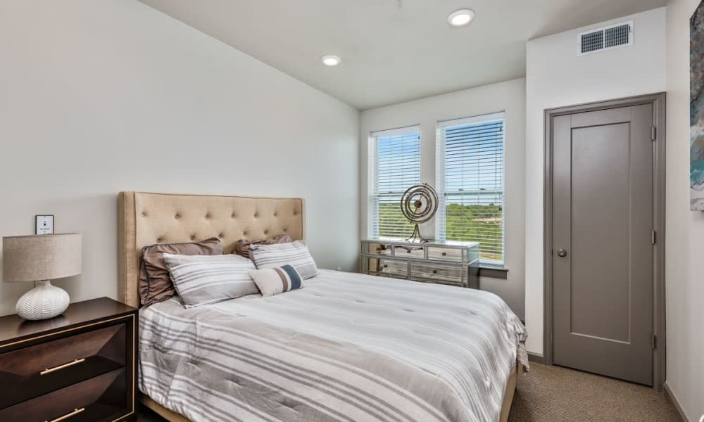 Model resident bedroom with natural light at Anthology of Clayton View in Saint Louis, Missouri.