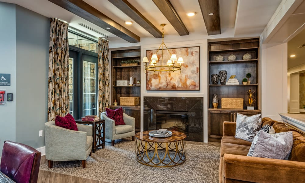 Resident lounge with a fireplace at Anthology of Town and Country in Town and Country, Missouri