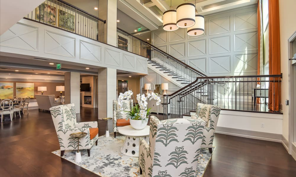Main entryway with a grand staircase at Anthology of Wildwood in Wildwood, Missouri