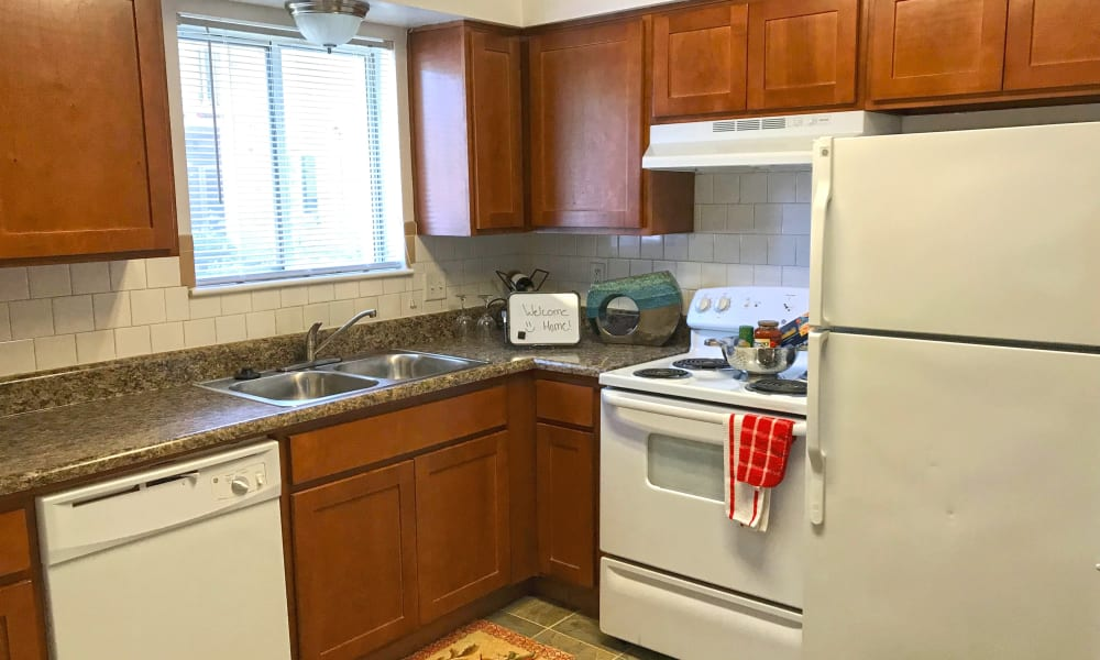 A kitchen with white appliances at Patriots Crossing in Newport News, Virginia
