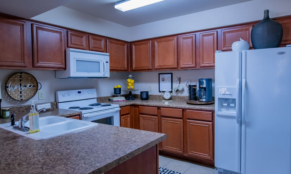 An apartment kitchen at Nickel Creek Apartments in Tulsa, Oklahoma