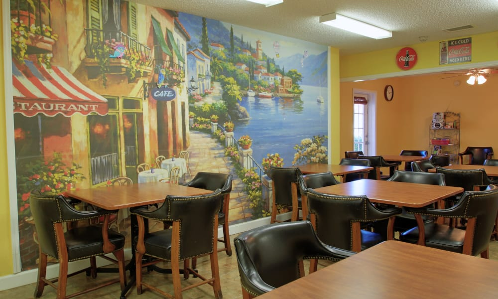 Dining area with cute mural on the wall at Bradenton Oaks in Bradenton, Florida