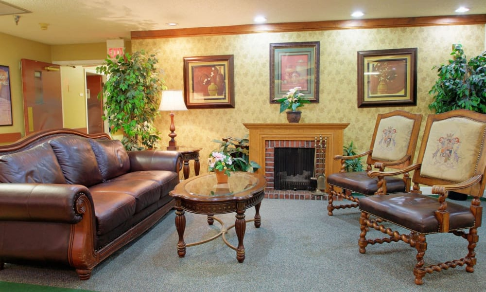 A visiting room with a fireplace at Forest Oaks of Spring Hill in Spring Hill, Florida
